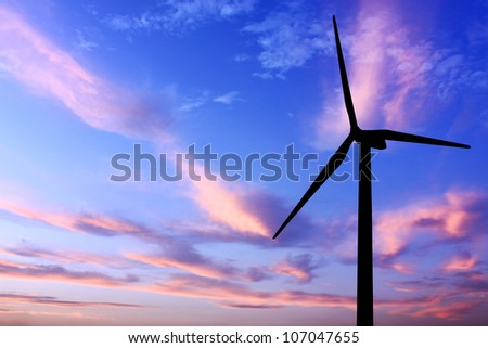 wind turbine generator with twilight sky on background - stock photo