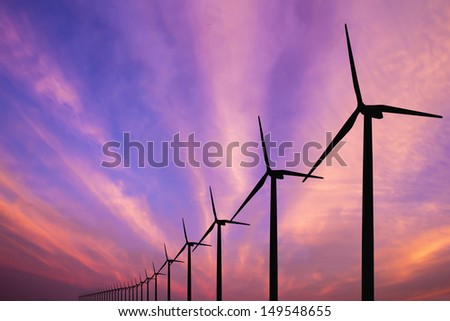 wind turbine generator with twilight sky on background