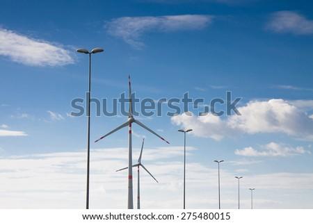 Wind Turbine in a blue sky - stock photo