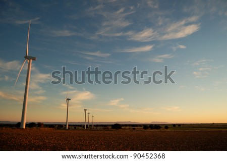 Wind turbine in a Spanish field at sunset