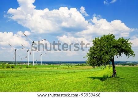 Wind turbine in green nature - stock photo