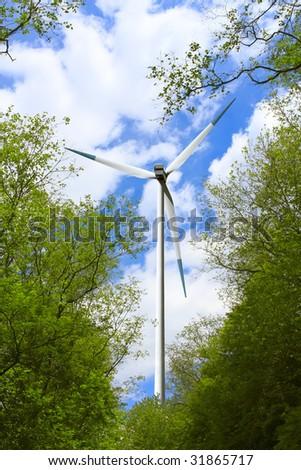 Wind turbine in nature hug - stock photo