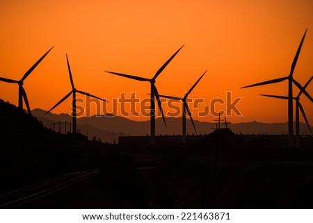 Wind Turbine in Utah at Sunset. Alternative Energy Source Theme. Wind Power. - stock photo