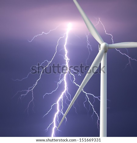 wind turbine on a background of sky with lightning - stock photo