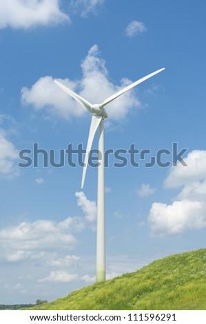 wind turbine on a green hill - stock photo