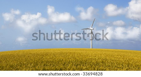 Wind Turbine on a yellow corn field - stock photo