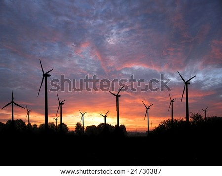 wind-turbine on background of the setting sun