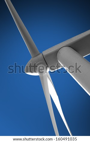 Wind turbine on blue sky - stock photo