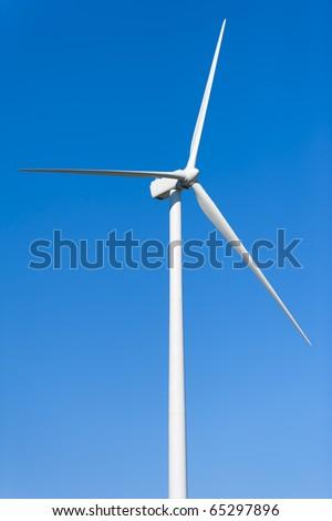 Wind Turbine on Clear Blue Sky - stock photo