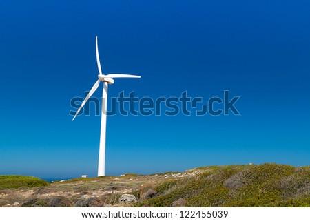 Wind turbine on the coast, Crete in Greece - stock photo