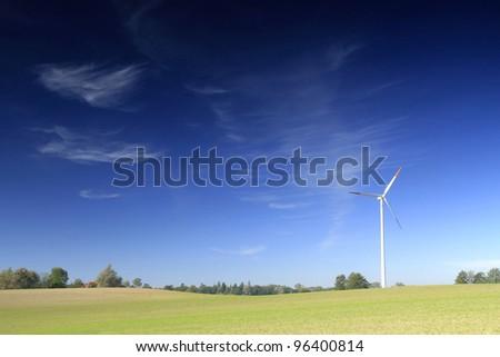 Wind turbine on the field crops - stock photo