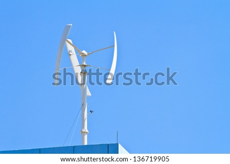 Wind turbine on the top of building - stock photo
