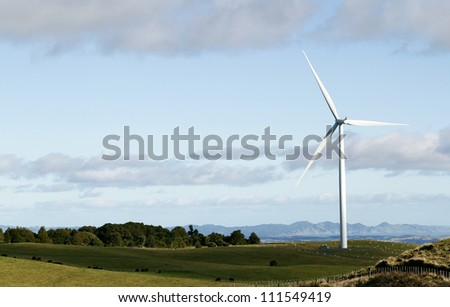 Wind turbine on top of hill.