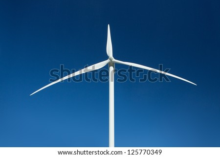 Wind turbine over deep blue sky