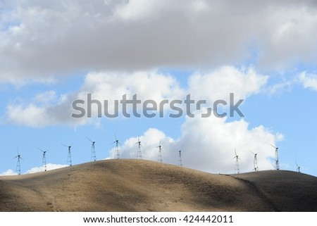 Wind turbine over mountain - stock photo