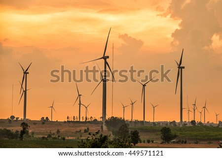 Wind turbine power at sunset - stock photo