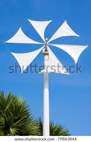 Wind turbine propeller blades against sky - stock photo