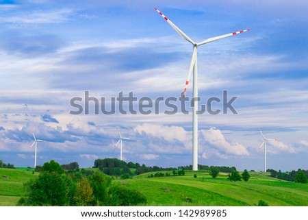 Wind turbine, renewable energy. Landscape with blue sky. - stock photo