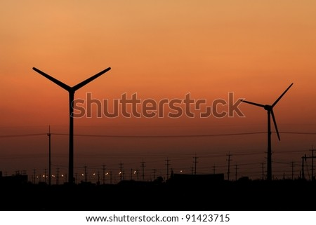 Wind turbine silhouette on twilight sky