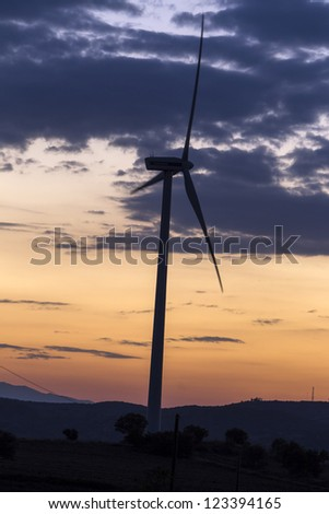 Wind turbine sunset background
