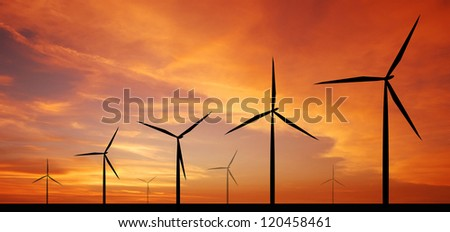 wind turbine sunset background ecosystem for design - stock photo