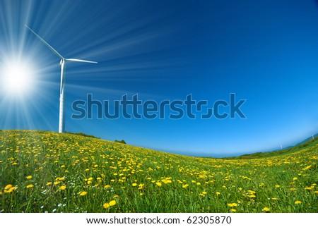Wind turbine under blue sky - stock photo