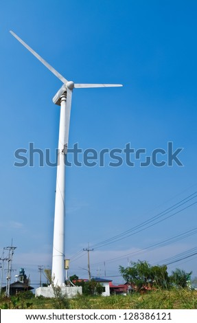 Wind turbine with blue sky background