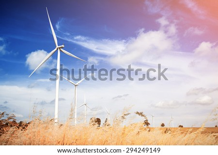 Wind turbine with blue sky, renewable energy - stock photo