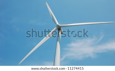 wind turbine with one blade in the horizontal position, read to produce power