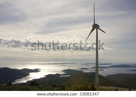 Wind turbine with sea and many islands in background