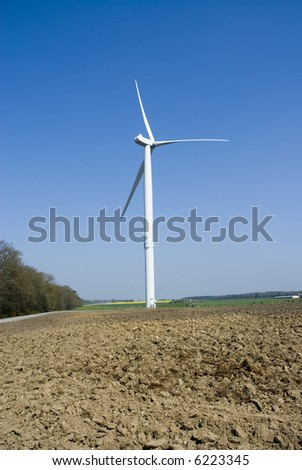 Wind Turbine with soil in foreground. Vertical view. - stock photo