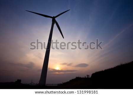 Wind turbine with sunset - stock photo