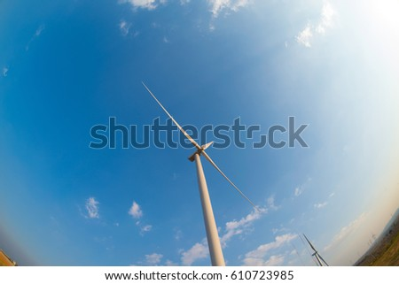 wind turbine with sunset. on fish eye view of urban backgrounds.