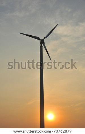 wind turbine with sunset scene