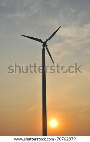 wind turbine with sunset scene - stock photo