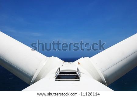 wind turbine with the blades in V-position for service and maintenance - stock photo