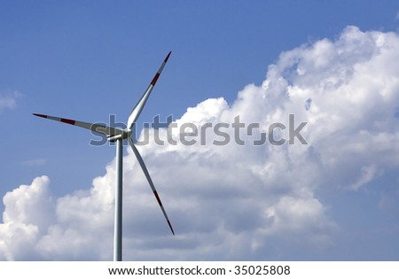 Wind turbine with white blades, great cloudscape - stock photo