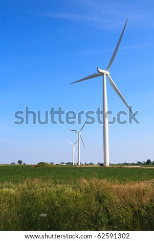 Wind Turbines against a Blue Sky in a Rural Setting - stock photo