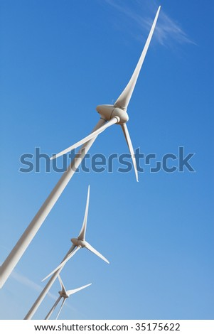 Wind turbines against prairie sky, create green energy. - stock photo