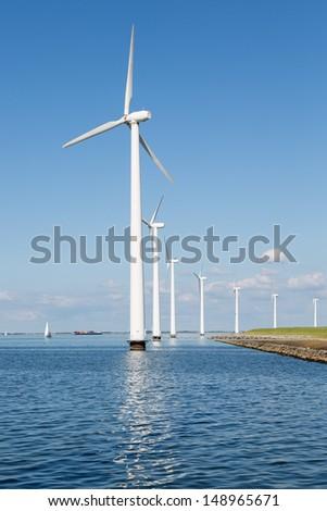 Wind turbines along Dutch coast near Urk - stock photo