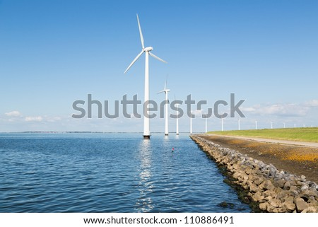 Wind turbines along the Dutch coast - stock photo