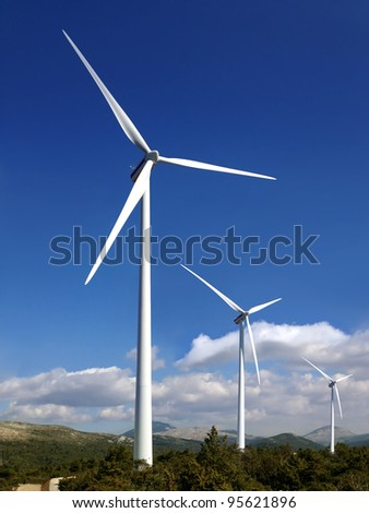 wind turbines alternative power resources - stock photo