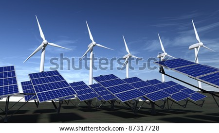 Wind turbines and articulated solar panels with a blue sky - stock photo