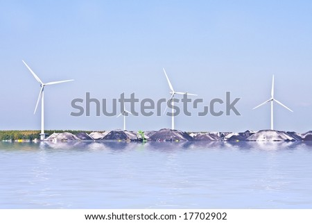 Wind-turbines and black coal mountains, green and dirty energy