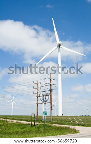 wind turbines and electric transmission lines located on farmland near Lake Benton, Minnesota - stock photo
