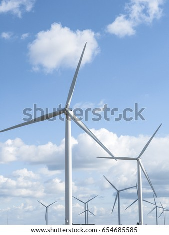 Wind turbines and electricity pylons.