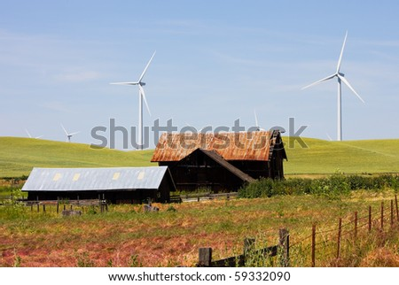Wind turbines and old house/barn - stock photo