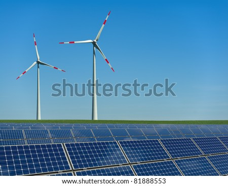 Wind turbines and solar panels in a field