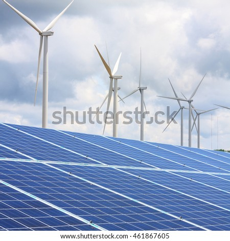 Wind turbines and solar panels with the clouds and sky, renewable energy