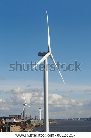 Wind turbines at the Port of Liverpool, England. The city skyline is seen in the background.